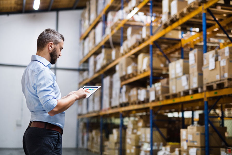 Wholesaler and Distributor Insurance - Man Examining How Much is Left in Stock