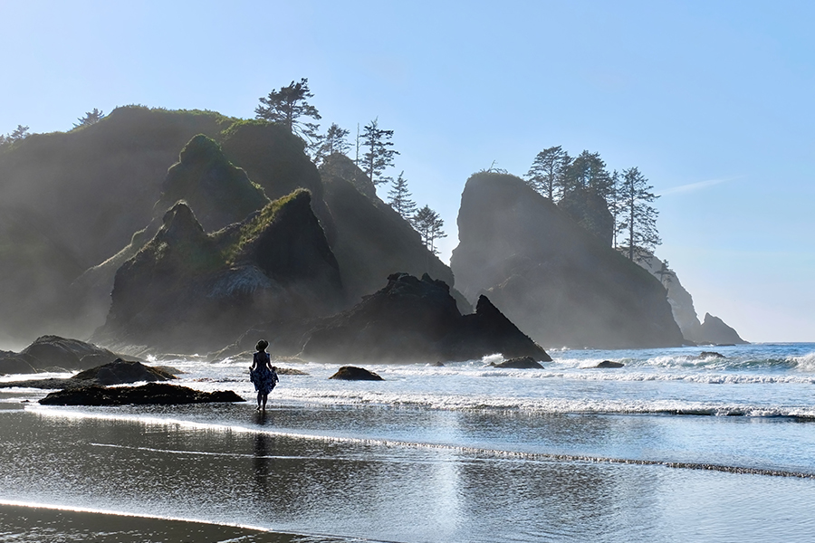 Contact - Woman Walking on Beach with Sea Stack Rocks in the Fog in Summer at Olympic Peninsula